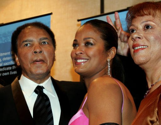 (AP Photo/John Amis, File). FILE - In this Feb. 26, 2005, file photo, former heavyweight boxing champion Muhammad Ali, left, jokingly holds up two fingers behind the head of his daughter, Laila Ali.